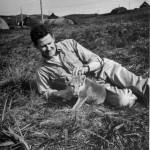 1943_A-GI-cuddling-a-pet-wolf-cub-Alaska-1943-520x540