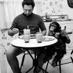 1971_A-man-eats-breakfast-with-his-pet-chimpanzee-US-1971