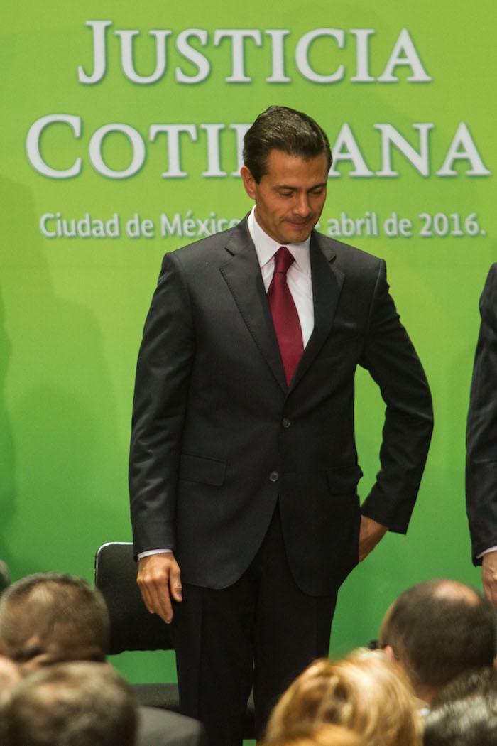 El presidente Enrique Peña Nieto, durante la ceremonia de Justicia Cotidiana en el Palacio Nacional. Foto: Cuartoscuro