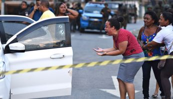 Brazil-rio-shoot-woman-crying-violence-gamechangersAP_19102117526026-1
