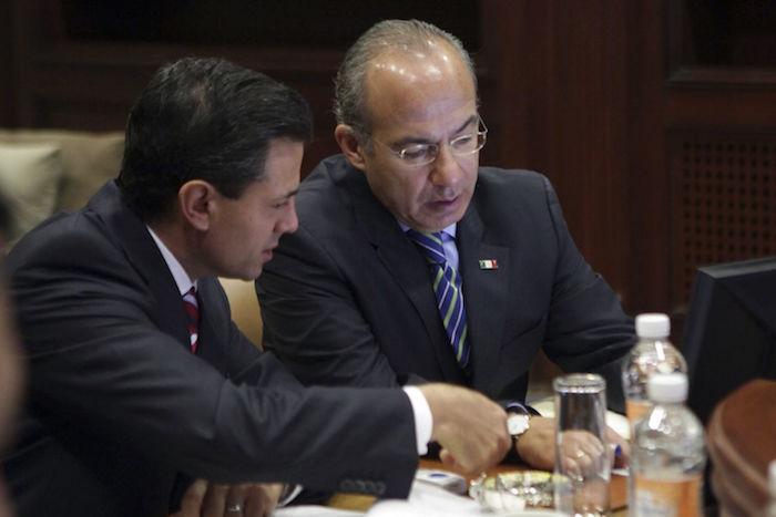 Los ex presidentes Peña Nieto y Felipe Calderón.  Foto: Cuartoscuro